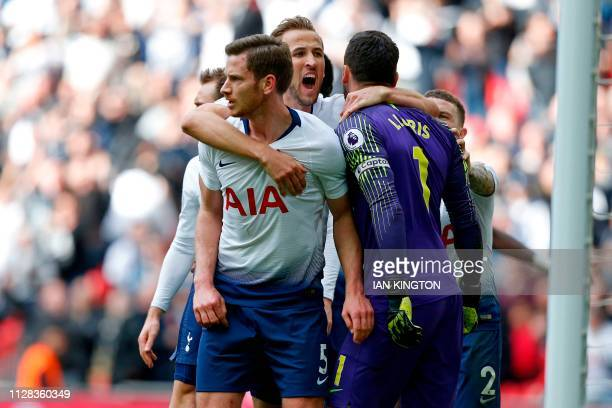 Tottenham Hotspur's English striker Harry Kane celebrates with Tottenham Hotspur's Belgian defender Jan Vertonghen and Tottenham Hotspur's French...