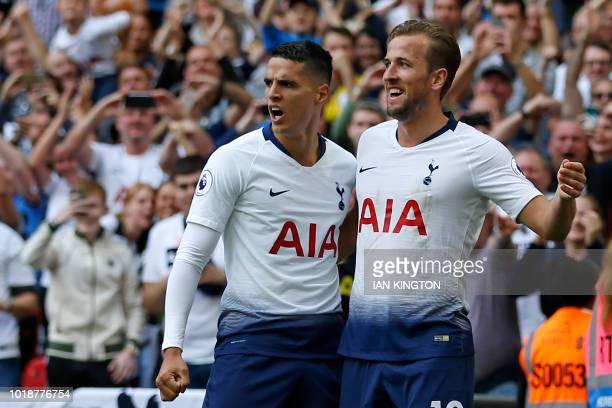 Tottenham Hotspur's English striker Harry Kane celebrates with Tottenham Hotspur's Argentinian midfielder Erik Lamela after scoring their third goal...