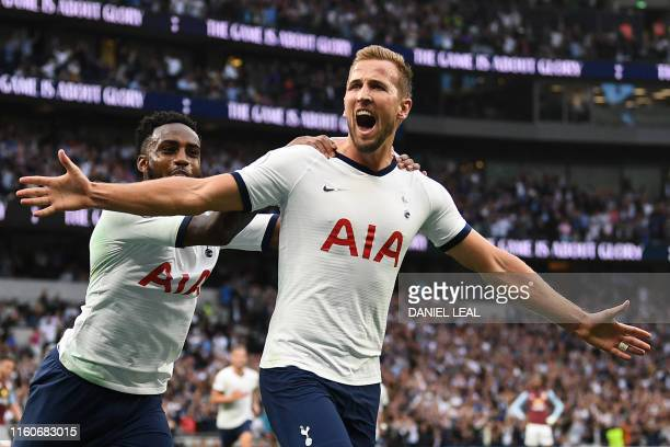 Tottenham Hotspur's English striker Harry Kane celebrates with Tottenham Hotspur's English defender Danny Rose after scoring the team's second goal...