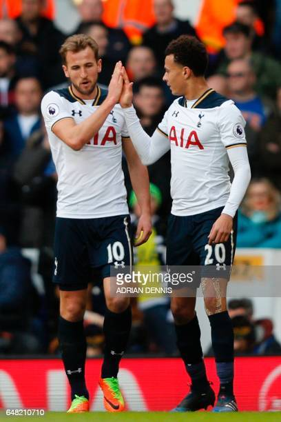 Tottenham Hotspur's English striker Harry Kane celebrates with Tottenham Hotspur's English midfielder Dele Alli after scoring the opening goal of the...