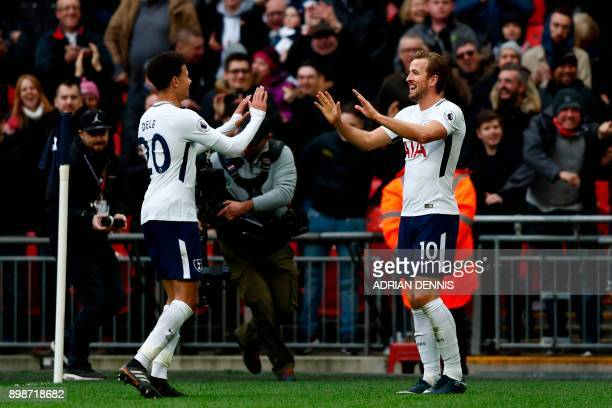 Tottenham Hotspur's English striker Harry Kane celebrates with Tottenham Hotspur's English midfielder Dele Alli after scoring his third goal their...