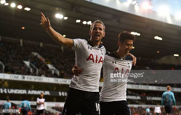 Tottenham Hotspur's English striker Harry Kane celebrates with Tottenham Hotspur's South Korean striker Son HeungMin after shooting from the penalty...