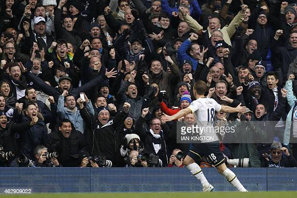 Tottenham Hotspur's English striker Harry Kane celebrates with the crowd after sdcoring an equalising goal to make the score 11 during the English...