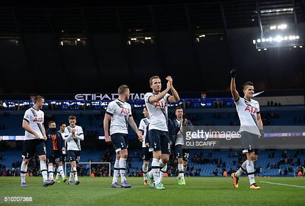 Tottenham Hotspur's English striker Harry Kane celebrates with teammates following the English Premier League football match between Manchester City...