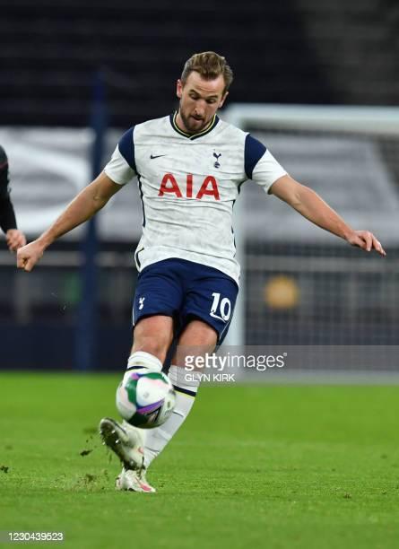 Tottenham Hotspur's English striker Harry Kane controls the ball during the English League Cup semi final first leg football match between Tottenham...