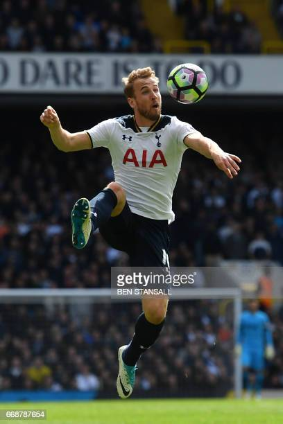 Tottenham Hotspur's English striker Harry Kane controls the ball during the English Premier League football match between Tottenham Hotspur and...