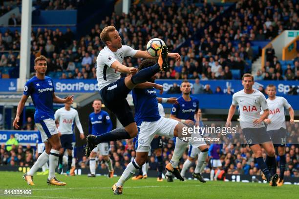Tottenham Hotspur's English striker Harry Kane controls the ball under pressure from Everton's Englishborn Welsh defender Ashley Williams during the...
