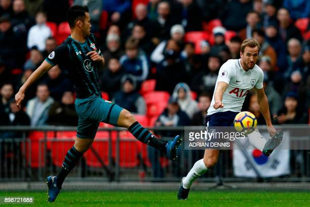 Tottenham Hotspur's English striker Harry Kane crosses the ball during the English Premier League football match between Tottenham Hotspur and...