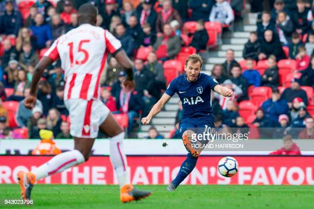 Tottenham Hotspur's English striker Harry Kane crosses the ball during the English Premier League football match between Stoke City and Tottenham...