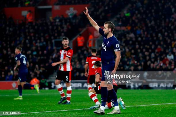 Tottenham Hotspur's English striker Harry Kane gestures having picked up an injury during the English Premier League football match between...