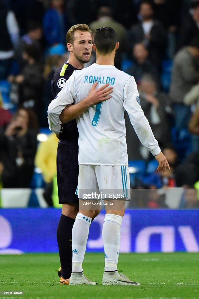 Tottenham Hotspur's English striker Harry Kane (L) greets Real Madrid's Portuguese forward Cristiano Ronaldo after the UEFA Champions League group H football match Real Madrid CF vs Tottenham Hotspur FC at the Santiago Bernabeu stadium in Madrid on October 17, 2017. /