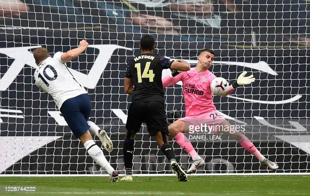 Tottenham Hotspur's English striker Harry Kane has a shot saved by Newcastle United's English goalkeeper Karl Darlow during the English Premier...
