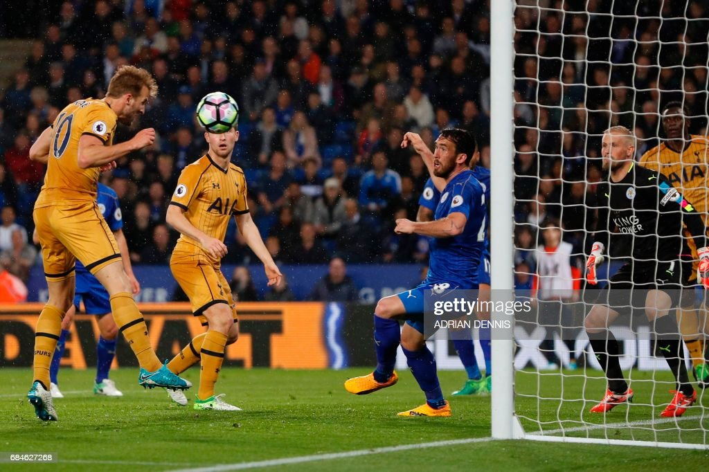 Tottenham Hotspur's English striker Harry Kane (L) heads home their third goal during the English Premier League football match between Leicester City and Tottenham Hotspur at King Power Stadium in Leicester, central England on May 18, 2017. / AFP PHOTO / Adrian DENNIS / RESTRICTED TO EDITORIAL USE. No use with unauthorized audio, video, data, fixture lists, club/league logos or 'live' services. Online in-match use limited to 75 images, no video emulation. No use in betting, games or single club/league/player publications. /