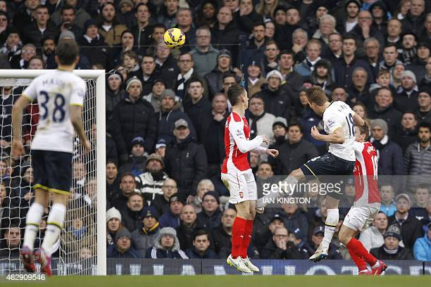 Tottenham Hotspur's English striker Harry Kane heads the ball to score their second goal during the English Premier League football match between...