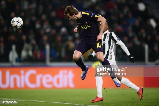 Tottenham Hotspur's English striker Harry Kane heads towards goal during the UEFA Champions League round of sixteen first leg football match between...