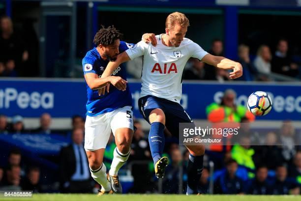 Tottenham Hotspur's English striker Harry Kane holds off Everton's Englishborn Welsh defender Ashley Williams during the English Premier League...