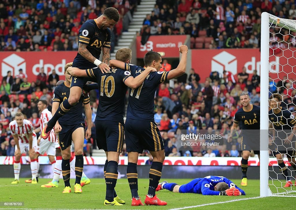 Tottenham Hotspur's English striker Harry Kane (C) is mobbed by teammates after scoring his team's fourth goal during the English Premier League football match between Stoke City and Tottenham Hotspur at the Bet365 Stadium in Stoke-on-Trent, central England on September 10, 2016. / AFP / Lindsey PARNABY / RESTRICTED TO EDITORIAL USE. No use with unauthorized audio, video, data, fixture lists, club/league logos or 'live' services. Online in-match use limited to 75 images, no video emulation. No use in betting, games or single club/league/player publications. /
