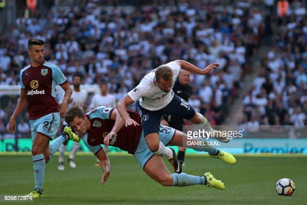 Tottenham Hotspur's English striker Harry Kane is tackled by Burnley's English defender James Tarkowski during the English Premier League football...