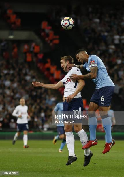 Tottenham Hotspur's English striker Harry Kane jumps for a header with Brighton's English midfielder Dale Stephens during the English Premier League...