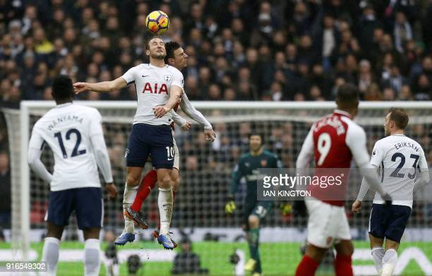 Tottenham Hotspur's English striker Harry Kane leaps for the ball against Arsenal's French defender Laurent Koscielny during the English Premier...