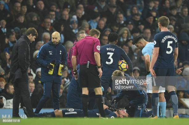 Tottenham Hotspur's English striker Harry Kane lies on the pitch after clashing with Manchester City's Argentinian defender Nicolas Otamendi during...