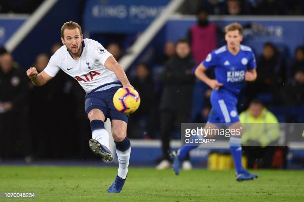 Tottenham Hotspur's English striker Harry Kane passes the ball during the English Premier League football match between Leicester City and Tottenham...
