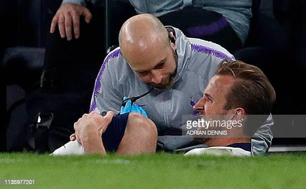 Tottenham Hotspur's English striker Harry Kane reacts after a tackle on Manchester City's English midfielder Fabian Delph but before leaving the...