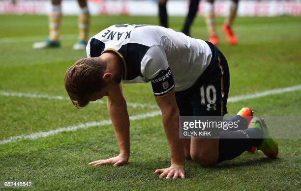 Tottenham Hotspur's English striker Harry Kane reacts after being tackled by Millwall's English defender Jake Cooper during the English FA Cup...