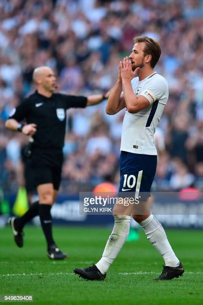 Tottenham Hotspur's English striker Harry Kane reacts to a missed shot at goal during the English FA Cup semifinal football match between Tottenham...
