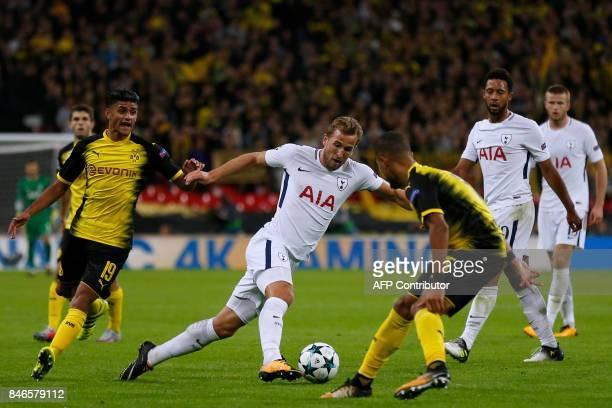 Tottenham Hotspur's English striker Harry Kane runs with the ball during the UEFA Champions League Group H football match between Tottenham Hotspur...