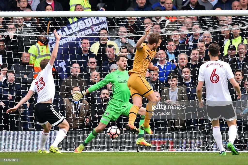 Tottenham Hotspur's English striker Harry Kane (2nd R) scores his and Tottenham's second goal past Fulham's English goalkeeper Marcus Bettinelli (2nd L) during the English FA Cup fifth round football match between Fulham and Tottenham Hotspur at Craven Cottage in London on February 19, 2017. / AFP / Glyn KIRK / RESTRICTED TO EDITORIAL USE. No use with unauthorized audio, video, data, fixture lists, club/league logos or 'live' services. Online in-match use limited to 75 images, no video emulation. No use in betting, games or single club/league/player publications. /