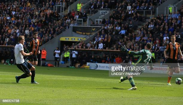 Tottenham Hotspur's English striker Harry Kane scores his hat trick and his team's fifth goal during the English Premier League football match...