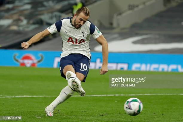 Tottenham Hotspur's English striker Harry Kane scores his penalty during the English League Cup fourth round football match between Tottenham Hotspur...