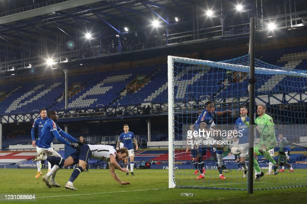 Tottenham Hotspur's English striker Harry Kane scores his team's fourth goal during the English FA Cup fifth round football match between Everton and...