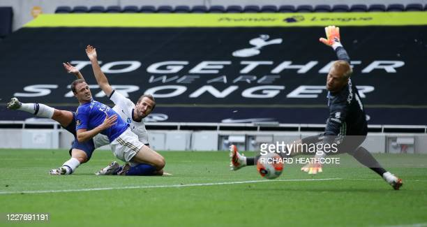 Tottenham Hotspur's English striker Harry Kane scores his team's second goal past Leicester City's Danish goalkeeper Kasper Schmeichel during the...