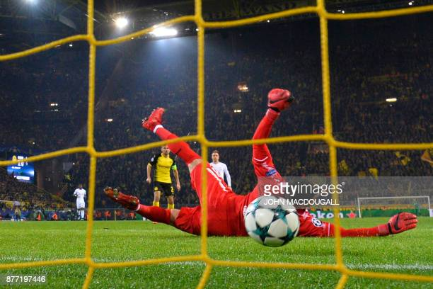 Tottenham Hotspur's English striker Harry Kane scores past Dortmund's Swiss goalkeeper Roman Buerki during the UEFA Champions League Group H football...