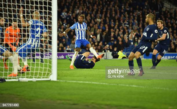 Tottenham Hotspur's English striker Harry Kane scores the opening goal during the English Premier League football match between Brighton and Hove...