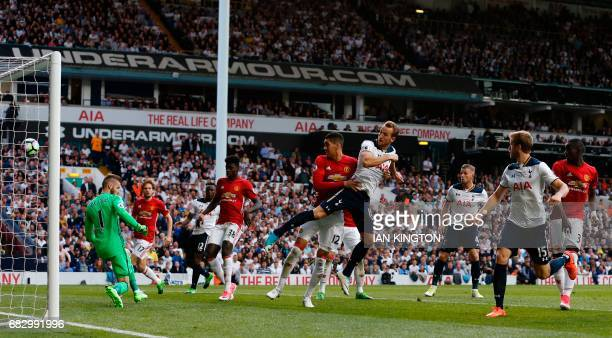 Tottenham Hotspur's English striker Harry Kane scores the second goal during the English Premier League football match between Tottenham Hotspur and...