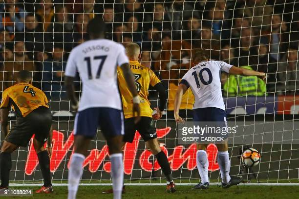 Tottenham Hotspur's English striker Harry Kane scores their first goal during the English FA Cup fourth round football match between Newport County...