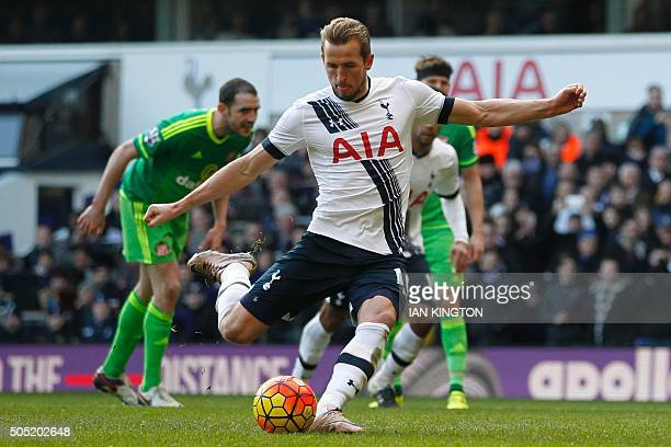 Tottenham Hotspur's English striker Harry Kane scores their fourth goal from the penalty spot during the English Premier League football match...