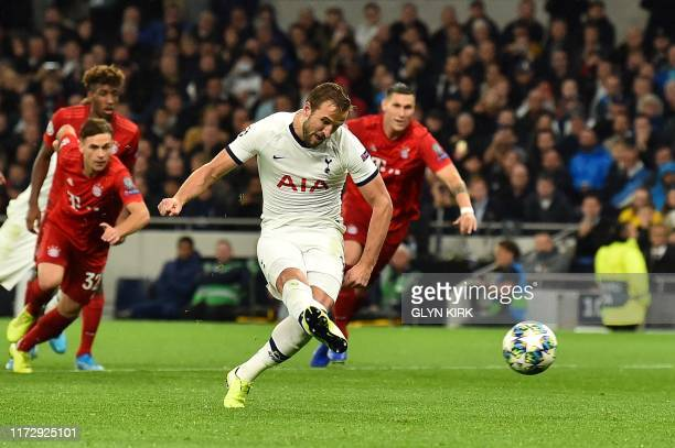 Tottenham Hotspur's English striker Harry Kane scores their second goal from the penalty spot during the UEFA Champions League Group B football match...