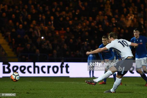 Tottenham Hotspur's English striker Harry Kane scores their second goal from the penalty spot during the English FA Cup fifth round football match...