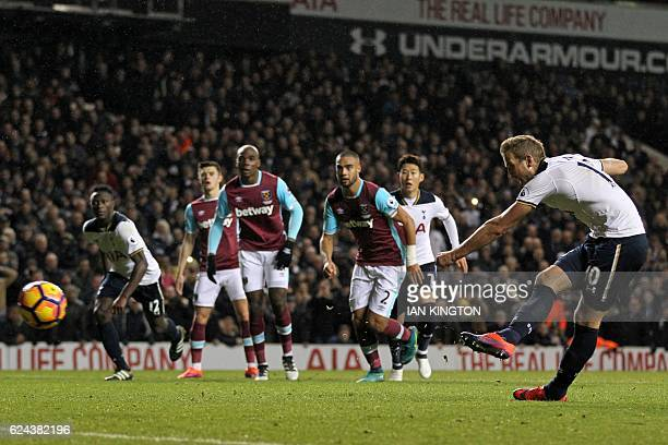 Tottenham Hotspur's English striker Harry Kane scores their third goal from the penalty spot during the English Premier League football match between...
