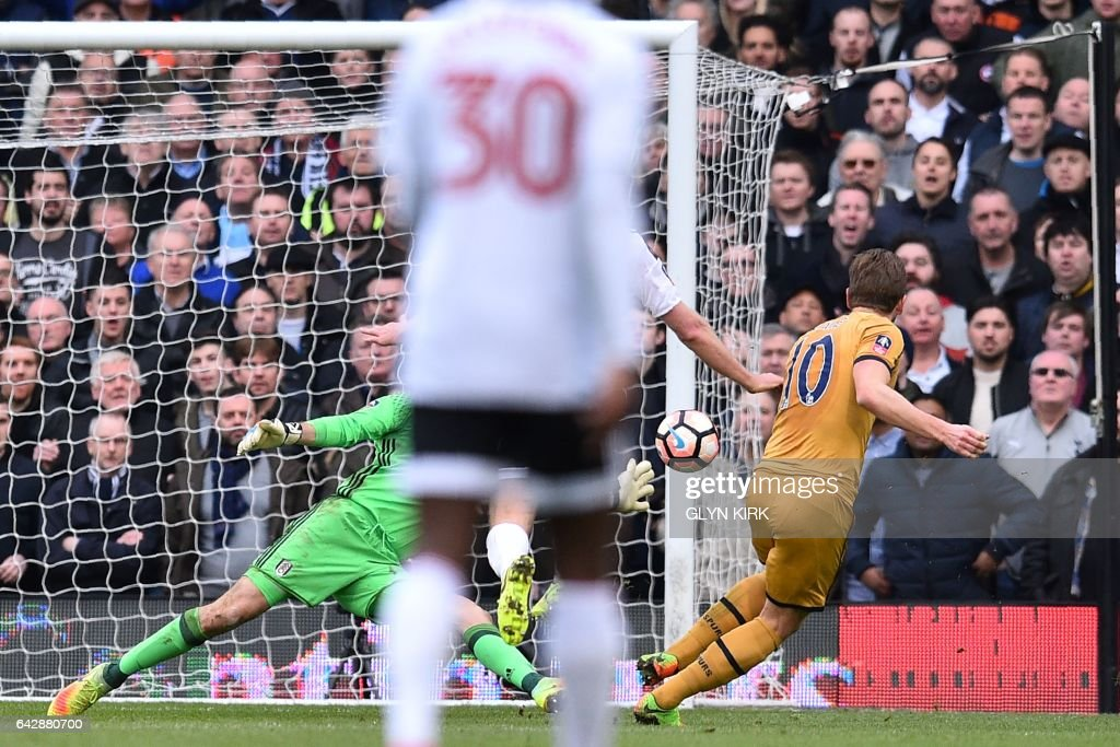 Tottenham Hotspur's English striker Harry Kane scores their third goal during the English FA Cup fifth round football match between Fulham and Tottenham Hotspur at Craven Cottage in London on February 19, 2017. / AFP / Glyn KIRK / RESTRICTED TO EDITORIAL USE. No use with unauthorized audio, video, data, fixture lists, club/league logos or 'live' services. Online in-match use limited to 75 images, no video emulation. No use in betting, games or single club/league/player publications. /
