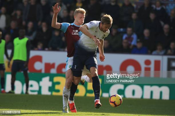 Tottenham Hotspur's English striker Harry Kane shoots and scores the equaliser during the English Premier League football match between Burnley and...