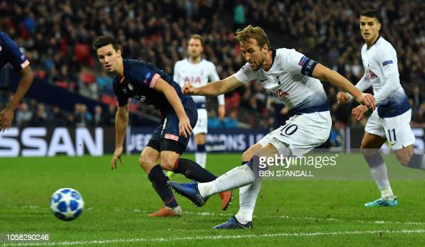Tottenham Hotspur's English striker Harry Kane shoots but fails to score during the UEFA Champions League group B football match between Tottenham...