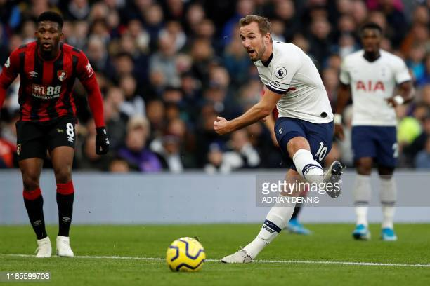 Tottenham Hotspur's English striker Harry Kane shoots but fails to score during the English Premier League football match between Tottenham Hotspur...