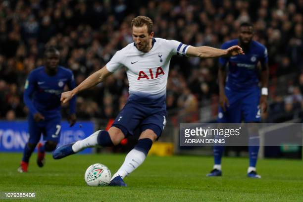 Tottenham Hotspur's English striker Harry Kane shoots from the penalty spot to score his team's first during the English League Cup semifinal...