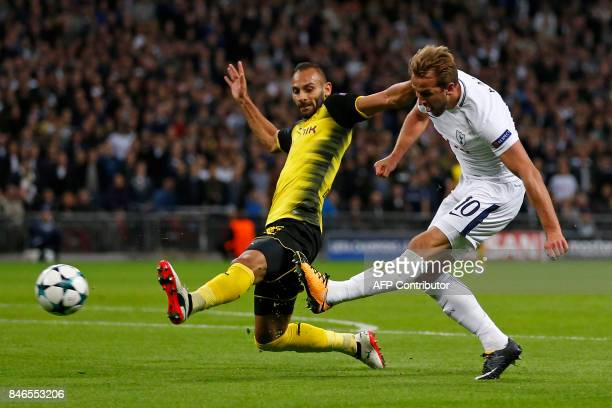 Tottenham Hotspur's English striker Harry Kane shoots past Borussia Dortmund's Turkish defender Omer Toprak to score their second goal during the...