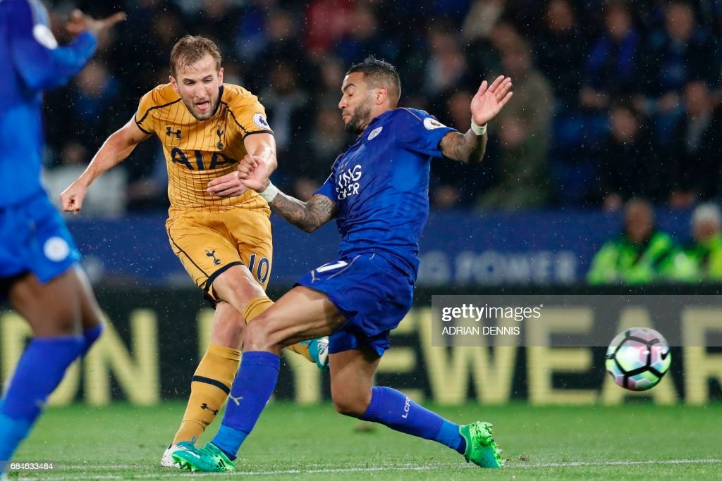 Tottenham Hotspur's English striker Harry Kane shoots past Leicester City's English defender Danny Simpson (R) to score his third goal, their fifth, during the English Premier League football match between Leicester City and Tottenham Hotspur at King Power Stadium in Leicester, central England on May 18, 2017. / AFP PHOTO / Adrian DENNIS / RESTRICTED TO EDITORIAL USE. No use with unauthorized audio, video, data, fixture lists, club/league logos or 'live' services. Online in-match use limited to 75 images, no video emulation. No use in betting, games or single club/league/player publications. /